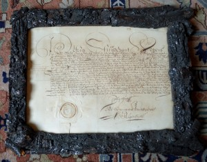 Govert Loockermans Land Patent signed by Petrus Stuyvesant in 1664 and framed in wood from a pear tree grown on the Director General's bouwerie.