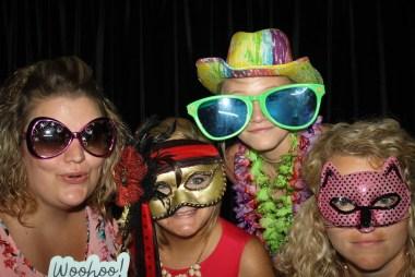 4 females at a photobooth