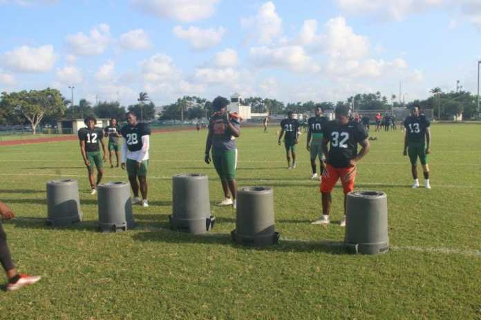 The McArthur defense at practice. Many of these football players have received interest from major college teams.