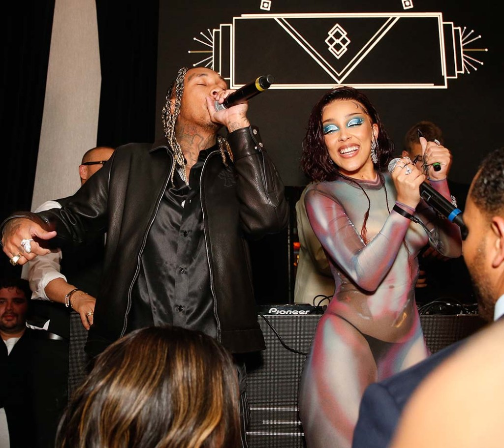 Tyga and Doja Cat perform at Darren Dzienciol and Richie Akiva's Oscar Party in Bel-Air on April 25, 2021.