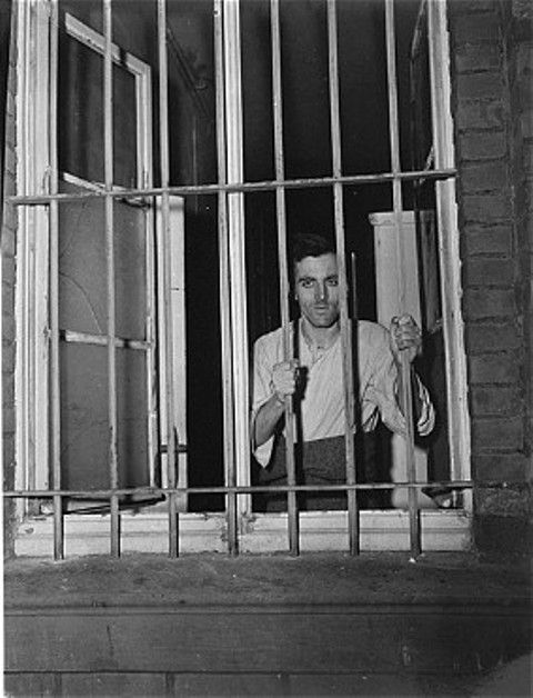 A survivor looks out a barred window at the Hadamar Institute