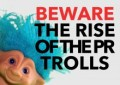 Photo of a blue haired troll doll to illustrate PR trolling
