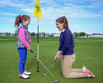 Image of young girl about to tee off