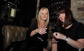 Two women are captured in a PR photograph at the launch of Edinburgh's Divino Enoteca