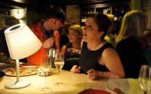 A guest orders a drink at the bar in a PR photograph taken at the launch of Edinburgh's Divino Enoteca