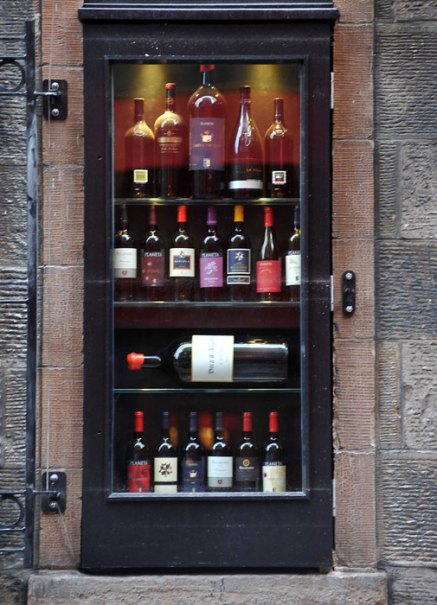 A selection of wine bottles form the window of Divino Enoteca in a food and drink PR image