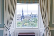 Hotel PR photography showing the stunning view from one of the bedrooms in Fraser Suites Edinburgh