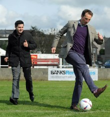 Banks Renewables director Colin Anderson enjoys a kickabout on the hallowed Cumnock Juniors turf with his colleague, Ryan Newall