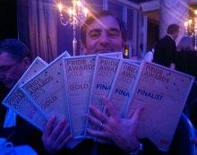 Raymond Notarangelo's armful of public relations awards for Holyrood PR
