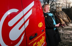 Ollie and handler leaning against the company van - Eagle Couriers