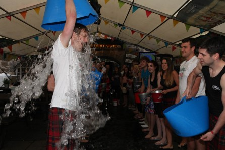 Challengers have to cover themselves in ice-cold water all in the name of charity.