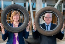 Jerry Stewart of Eagle Couriers celebrates the firm's recylcing credentials with Green MSP Alison Johnstone