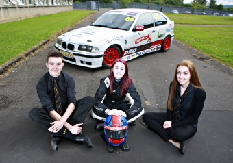GOOD EGG YOUNG DRIVER SAFETY CAMPAIGN WITH SCOTTISH SUN RACER CHRISTIE DORAN AT KILSYTH ACADEMY, GLASGOW. PIC SHOWS LEARNER DRIVERS ROSS LEONARD AND FIONA MILLER WITH CHRISTIE AND HER BMW COMPACT CUP RACE CAR. FOR FULL DETAILS CONTACT JAN JAMES 07980 851360/jan@dynamicadgroup.com