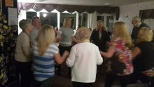 Care home residents sing Auld Lang Sybe