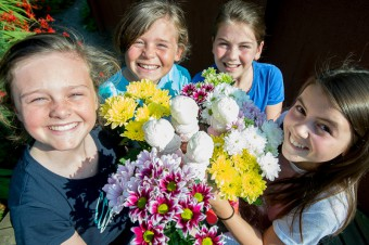 Kids pose with flowers for food and drink pr