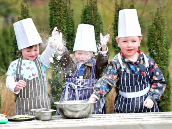 Small children having fun with flour and baking - PR photos by Holyrood PR in Edinburgh