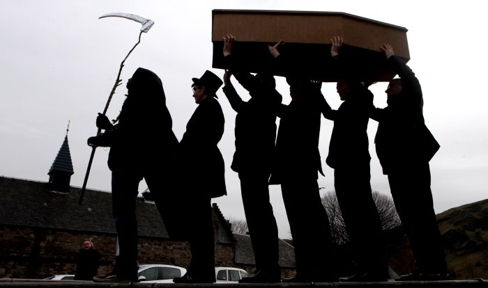 A mock funeral processions led by the Grim Reaper - public relations photo for Hallowe'en