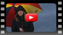 Woman under umbrella, presenting episode 184 of Holyrood PR TV