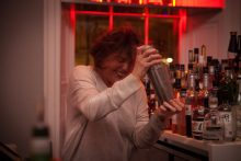 Hotel PR photograph of excited Tigerlily customer making a cocktail in Tigerlily