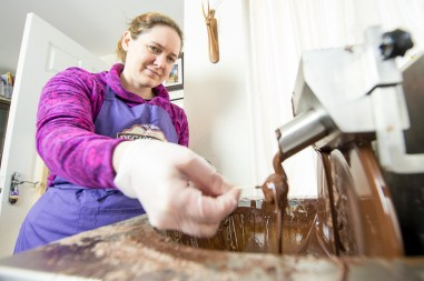 A chocolatier coats sprouts in chocolate to be served at The Perth winter festiva;