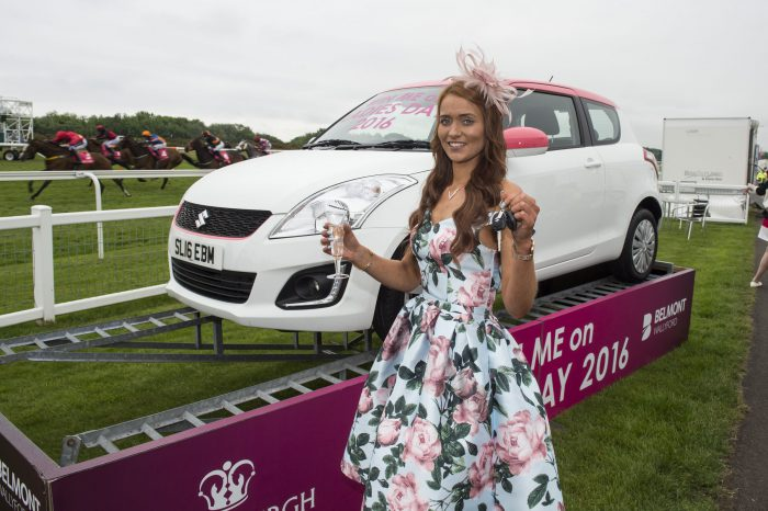 Musselburgh Racecourse Stobo Castle Ladies Day 2016. This year's Queen of Style winner, Michelle Gardiner from Falkirk, with the keys to her new car.