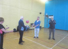 Elderly BUpa care home residents enjoy a netball class