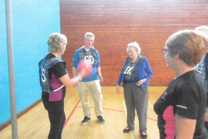 Elderly Bupa care home residents play netball