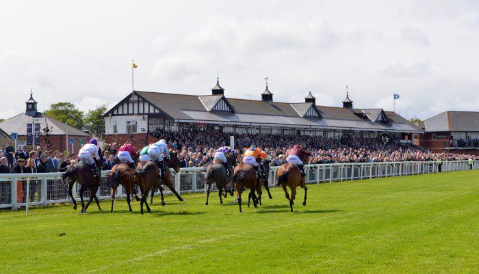 Six jockeys racing at Musselburgh Racecourse