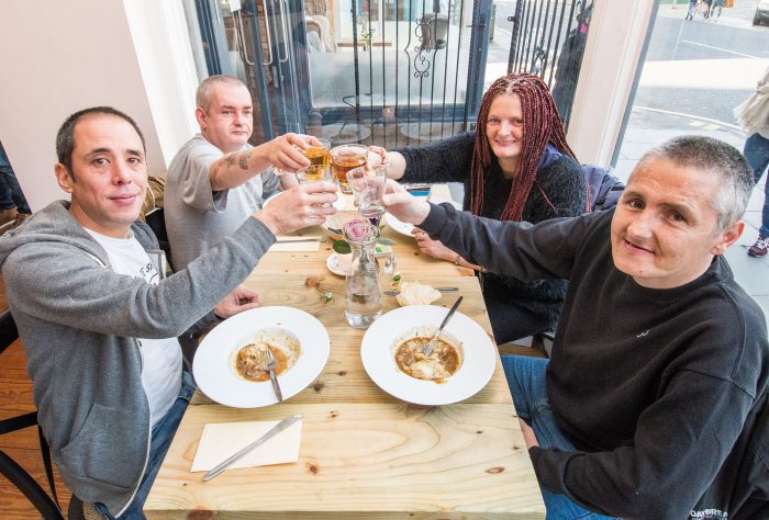 "Photographer Ian Georgeson, 07921 567360 Pic: Back left - James Sutherland Front left - Daryn Sabiston Back right - Michelle Dounie Front right - Sean Macinnes Restaurant Welcomes First Homeless Guests to Dine in Style Homeless people in Edinburgh have today (Mon) been treated to a fine dining meal at a chic new restaurant for the first time. Maison Bleue at Home opened in Edinburgh to a fanfare of praise just two weeks ago with a promise to feed members of the homeless community once a week, while also contributing its profits to charity. Now, the Queensferry Street eatery -run by renowned father and daughter restaurateurs Dean and Layla Gassabi - has debuted its special meal service, made possible by ""pay it forward"" contributions from diners. Guests were treated to a choice of venison haunch casserole with Mouselline cheesy mash or a wild mushroom penne pasta dish, followed by apple and red berry crumble with vanilla ice cream. Those taking part were selected by three homeless charities, Social Bite, Crisis and The Big Issue and booked their places through Social Bite cafes. They dined in small groups, accompanied by volunteers. Diner Michelle Dounie said: ""The staff were great and the food was amazing – I would easily give it five stars. We were even given food to take away aswell, which was just superb. ""The atmosphere was perfect too, really calm. You would never think that you were sitting with homeless people having a meal. I was with my partner and it just felt like my partner had taken me out for a lovely dinner."" Fellow diner, Natalie Mullen, commented: ""I really enjoyed it my first experience at the restaurant. ""It was good to come along, get out of the cold and enjoy a hot meal in the company of other folk who are in the same situation. I would definitely recommend it to others."" The restaurant is staffed, run and designed by the Maison Bleue team and for this venture, they are working in partnership with Josh Littlejohn of the Social Bite sandwich chain, a social enterprise which supports homeless people. Layla said: ""It's wonderful that Maison Bleue now has the opportunity to give something back to the homeless community and, in the process, donate profits to charities that are very close to our hearts. ""Our first sitting for homeless guests was a fantastic success. We were determined to make sure everyone really enjoyed the experience and that our guests received the same quality of service and delicious home-cooked meals as all our customers do. ""The feedback has been fantastic. Everybody really enjoyed it and we are excited to now begin this initiative on a weekly basis."" Matt Kelly, Manager of Maison Bleue at Home, added: ""Our aim is to help combat homelessness by providing those less fortunate with a nutritious and filling meal in a relaxed, friendly and safe environment – which is exactly what we have done today. ""The generosity of diners as part of our 'pay it forward' scheme has been very heartening and we hope the service was beneficial for those who came along."" Since opening its doors the restaurant has been a hit with diners impressed by Maison Bleue's hallmark eclectic mix of Scottish and French-inspired cuisine, with many making taking the chance to make ""pay it forward"" contributions. The sittings for homeless guests will run weekly on a Monday from 3-5pm and will see 50 guests enjoy a choice of two freshly cooked courses and dessert, which have been specially selected to provide a hearty meal for vulnerable members of society. Places can be booked through the Social Bite cafes. Josh Littlejohn sees the restaurant's social enterprise ethos as a natural evolution of the Social Bite chain which he founded. The ""sandwich shops with a difference"" use a similar pay it forward model to provide food for homeless people. Meanwhile one in four of Social Bite's staff were formerly homeless. Josh added: ""We want the Monday meal services to be an opportunity for the homeless community to eat with dignity - not to offer a handout but a hand up - to employment, stability and self-worth. ""It's a natural evolution of what we've been doing at Social Bite and it's fantastic to see people are getting on board and supporting us in the same way."" Maison Bleue at Home will be giving 100% of its profits to charity – 50% directly to Social Bite and 50% to other good causes chosen by staff. The restaurant will also provide a training and employment programmes for members of the Social Bite Academy, a four-year paid course for homeless people. The venture is backed by an impressive list of prominent names from the Scottish restaurant scene. Along with Dean and Josh, other board members including David Wither of the Montpelier Group, restaurateur Simon Littlejohn and Michelin-starred chef Martin Wishart. For more information and to book, please visit: www.home-restaurant.co.uk ENDS Issued on behalf of Maison Bleue by Holyrood Partnership, 0131 561 2244 or info@holyroodpr.co.uk"