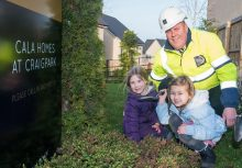 PR Photos of two kids and CALA Representative planting the daffodil bulbs