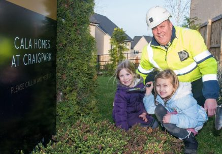 PR Photos of two kids and CALA Representative planting the daffodil bulbs