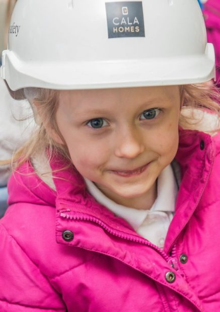 Close-up PR Photos of one of the kids from Ratho Primary School wearing a helmet
