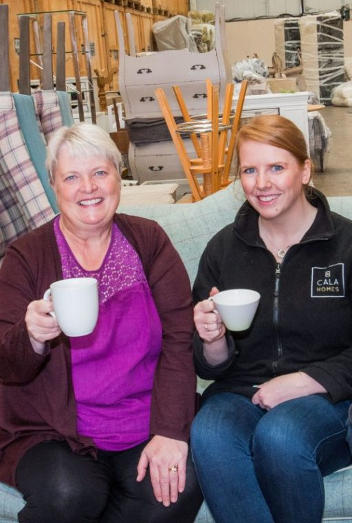PR Photos of Claire McLoughlin, Marketing Assistant at CALA Homes (East) and Lynne McNicoll Director of Charity It's Good to Give drinking tea together.