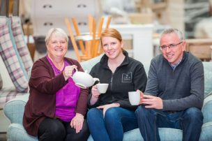 PR Photos of Claire McLoughlin, Marketing Assistant at CALA Homes (East), Lynne McNicoll, Director of Charity It's Good to Give and Keih Robertson Director at Fresh Start enjoying a cup of tea together.