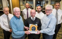 PR Photography of Site Manger Francis Cassidy presents the defib to Allan Murray Vice Chair of Currie Community council and Allister McKillop Chair of Currie Community Council