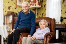 An older couple living together in a care home
