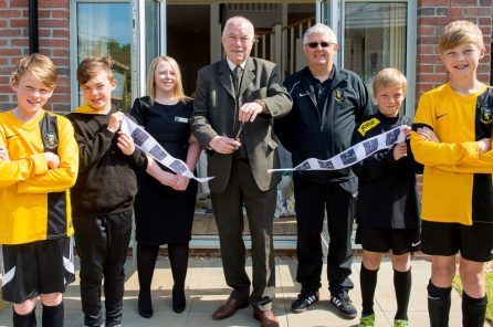 Councillor Ricky Henderson cuts the ribbon to open Kinleith Mills showhomes alongside players from Currie F.C. captured by PR Photography