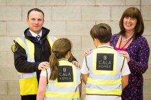 PR Photography captures the moment Two children from Loanhead Primary School show off the back of their new high-visibility jackets alongside their Headteacher and a representative from CALA Homes
