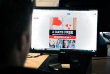 Someone sitting in front of a computer displaying one of the many dating scam emails our PR Agency are trying to raise awareness about