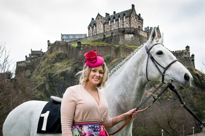 A behind the scenes photo of Musselburgh PR Photography, featuring a girl with a white horse in front of Edinburgh Castle.