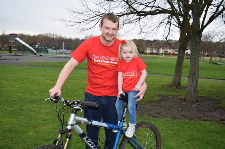 Ryan and Orla pose on bike for Scottish PR Agency Story