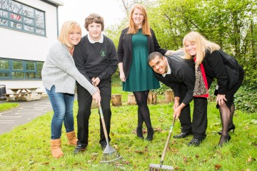 A picture of Pupils at Woodlands Special School with Gardening Equipment Donated by CALA Homes for Photography PR