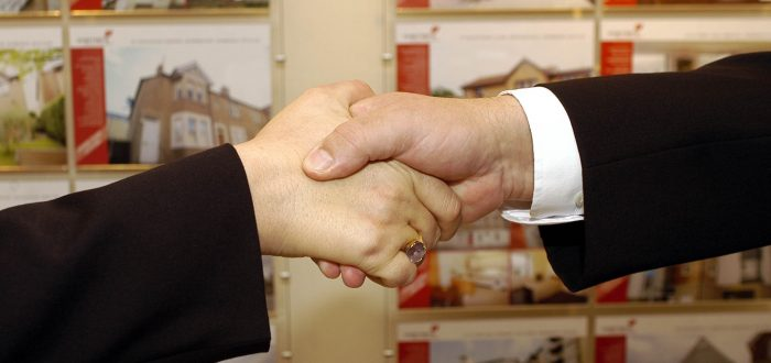 PR photography of a handshake an image from a column by Scott Douglas, director of PR agency