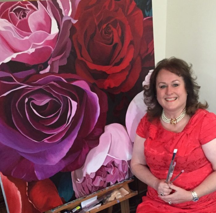 Scottish artist Susie Capaldi, who paints flowers posed in front of a painting as part of a release from a PR Agency