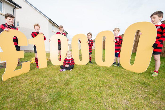 Team members pose for Edinburgh PR story