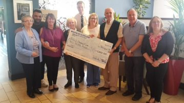 Eagle Lodge being presented with the cheque photo hosted by Care PR
