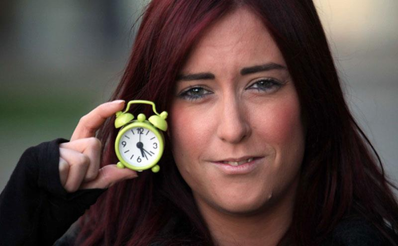 PR photograph of woman holding a small clock