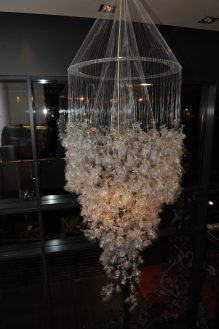 Food and drink PR photography of hand mande wine glass chandelier, in Hyde Out style bar in Edinburgh.
