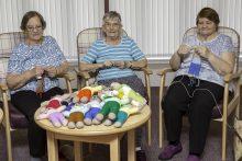 "Care PR photograph of Bield tenants knitting ""The Trauma Teddies"" for Police Scotland | Scottish PR"