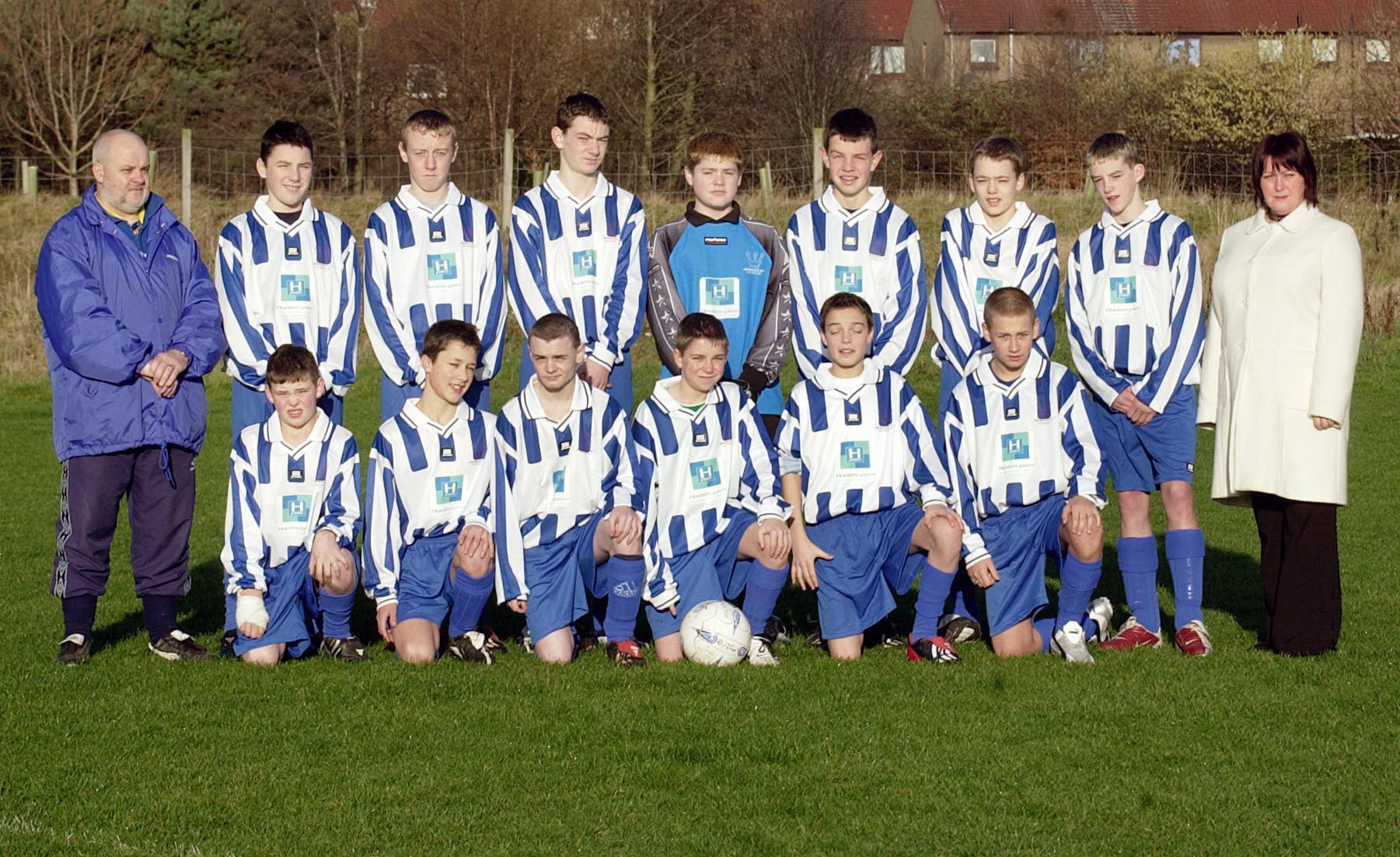 Legal PR photography of Aberdour FC's 15s squad, kit sponsored by The PSM Law Group